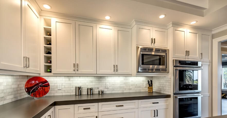 Greenfield Kitchen Cabinets Part - 28: We Love How They Utilized All The Space With Cabinets Which Also Includes A  Built In Wine Rack/shelf. The Dark Countertops, Stainless Steel Appliances  And ...